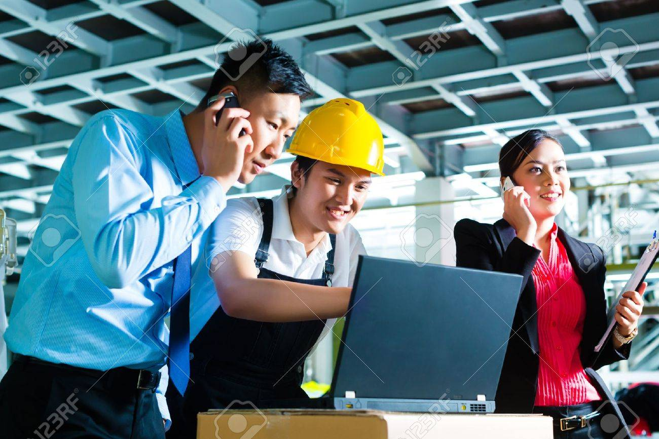 stock photo worker or production manager and customer service look on a laptop in a textile factory and help on the phone - Fashion Production Manager