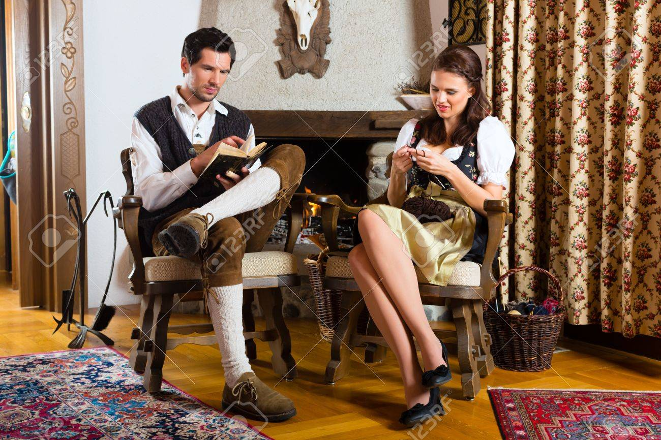 Couple in a traditional mountain hut with fireplace Stock Photo - 20836789