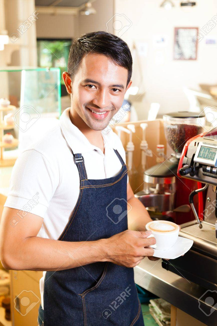 Coffeeshop - asian barista presents coffee in his shop Stock Photo - 20836832