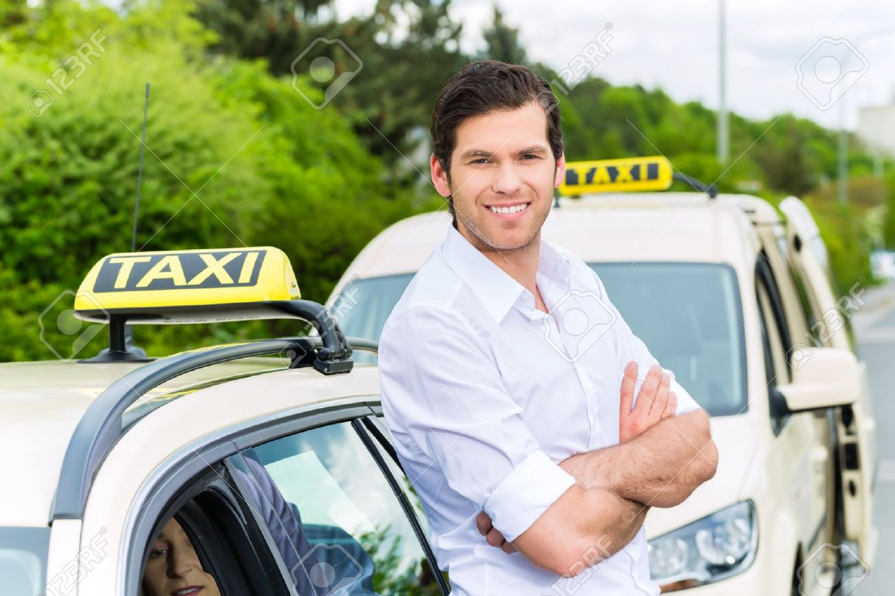 Experienced Taxi Driver In Front Of His Taxi, Waiting For A Passenger Stock  Photo