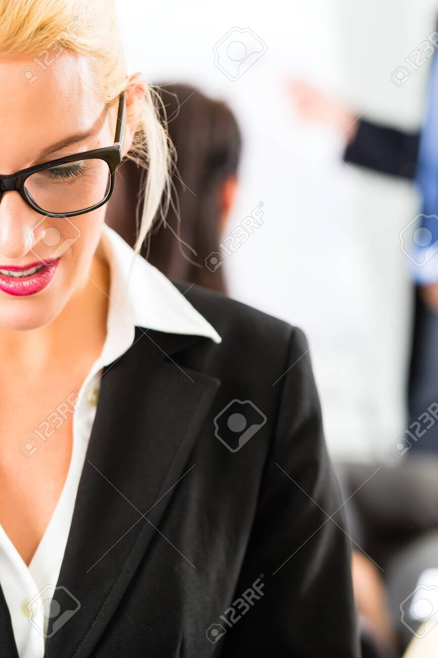 Business - businesspeople have team meeting or workshop in an office - Portrait of a businesswoman Stock Photo - 21401587