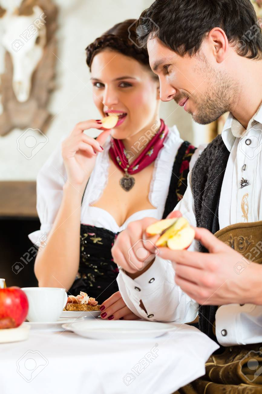 Couple in a traditional mountain hut having a meal Stock Photo - 22046423