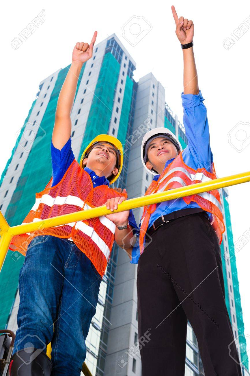 Chinese architect and supervisor on construction site point into the distance Stock Photo - 22046528