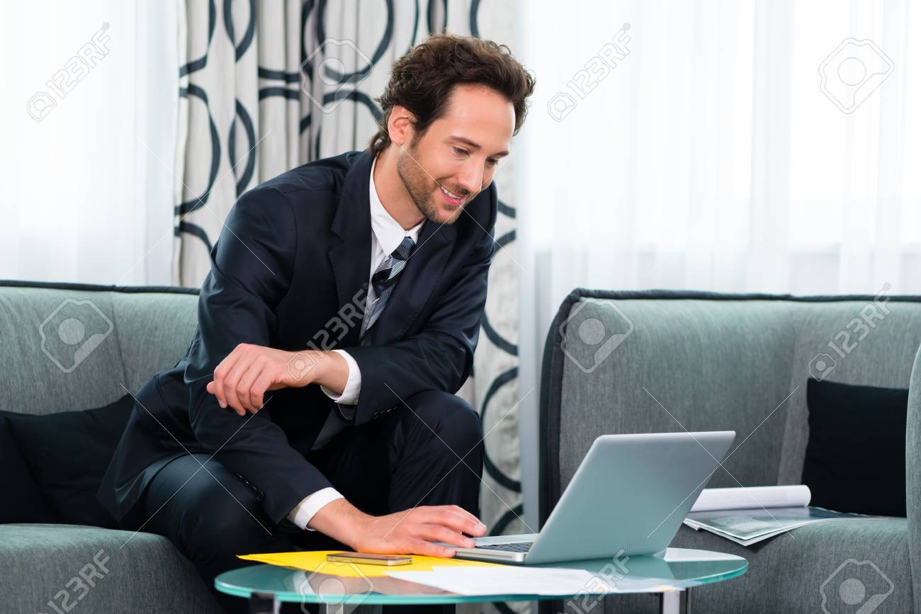 Businessman working in business hotel, he is using wifi to read emails with the computer Stock Photo - 22046750