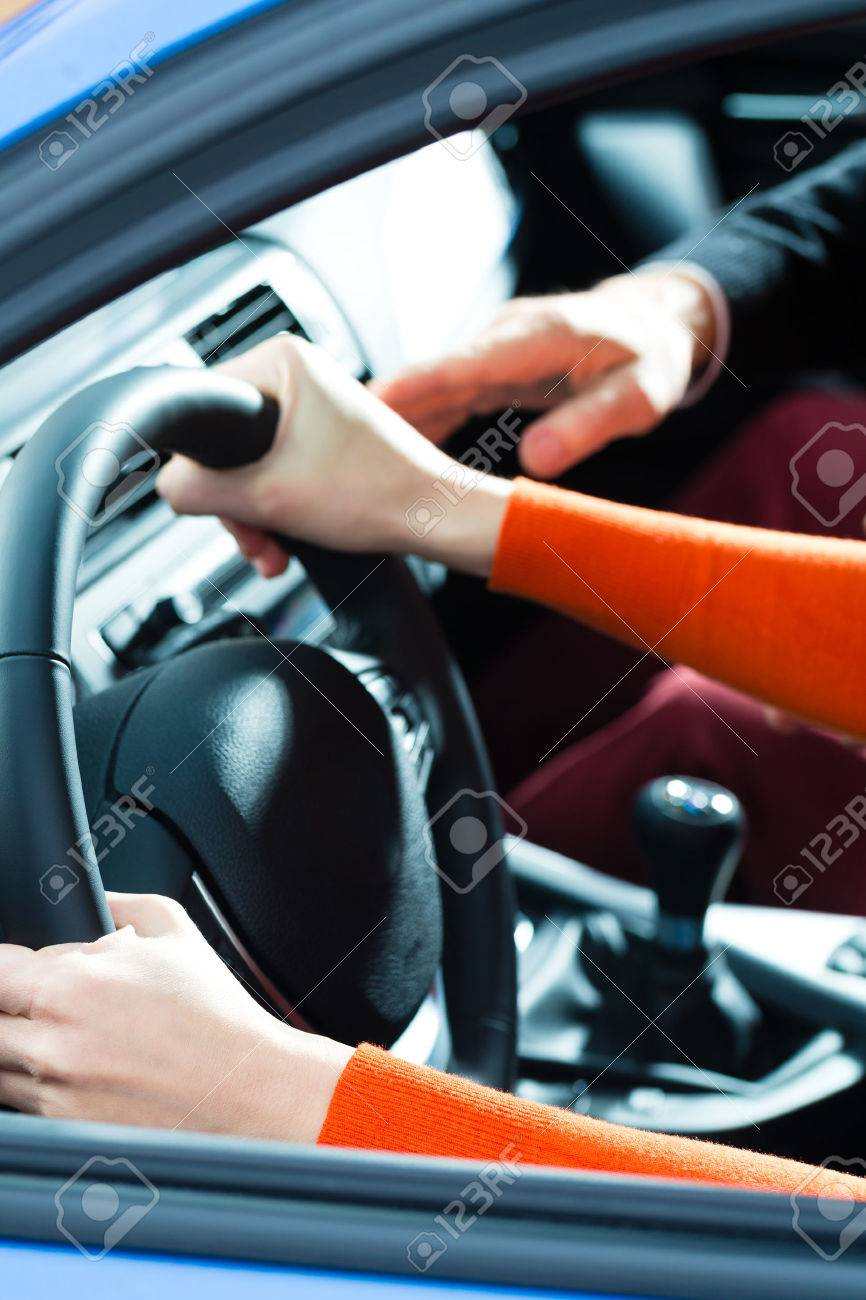 driving school young woman steer a car with the steering wheel