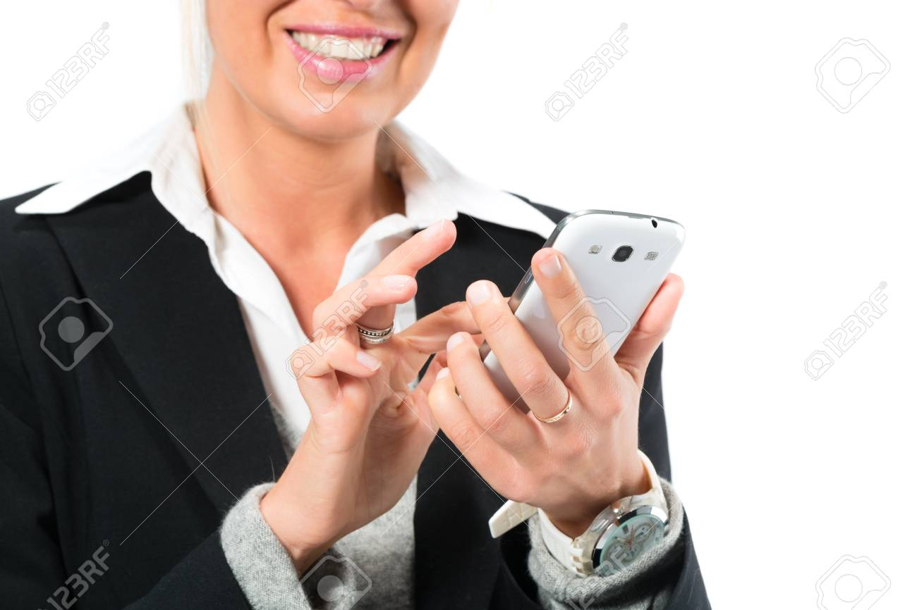 Young woman in front of white background, writing email or texting with her phone or Smartphone, maybe she is a businesswoman or laywer Stock Photo - 24283909