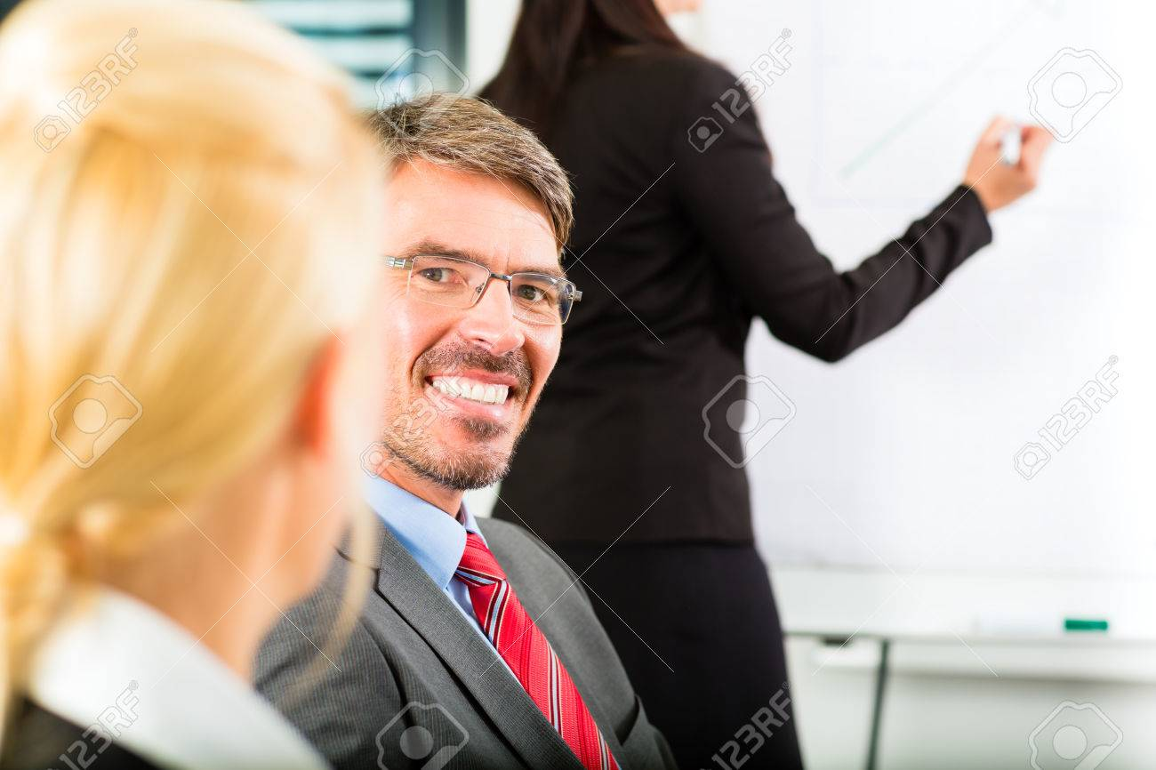 Business - businesspeople have team meeting or workshop in an office, it is a very good team – Portrait of a businessman Stock Photo - 24283915