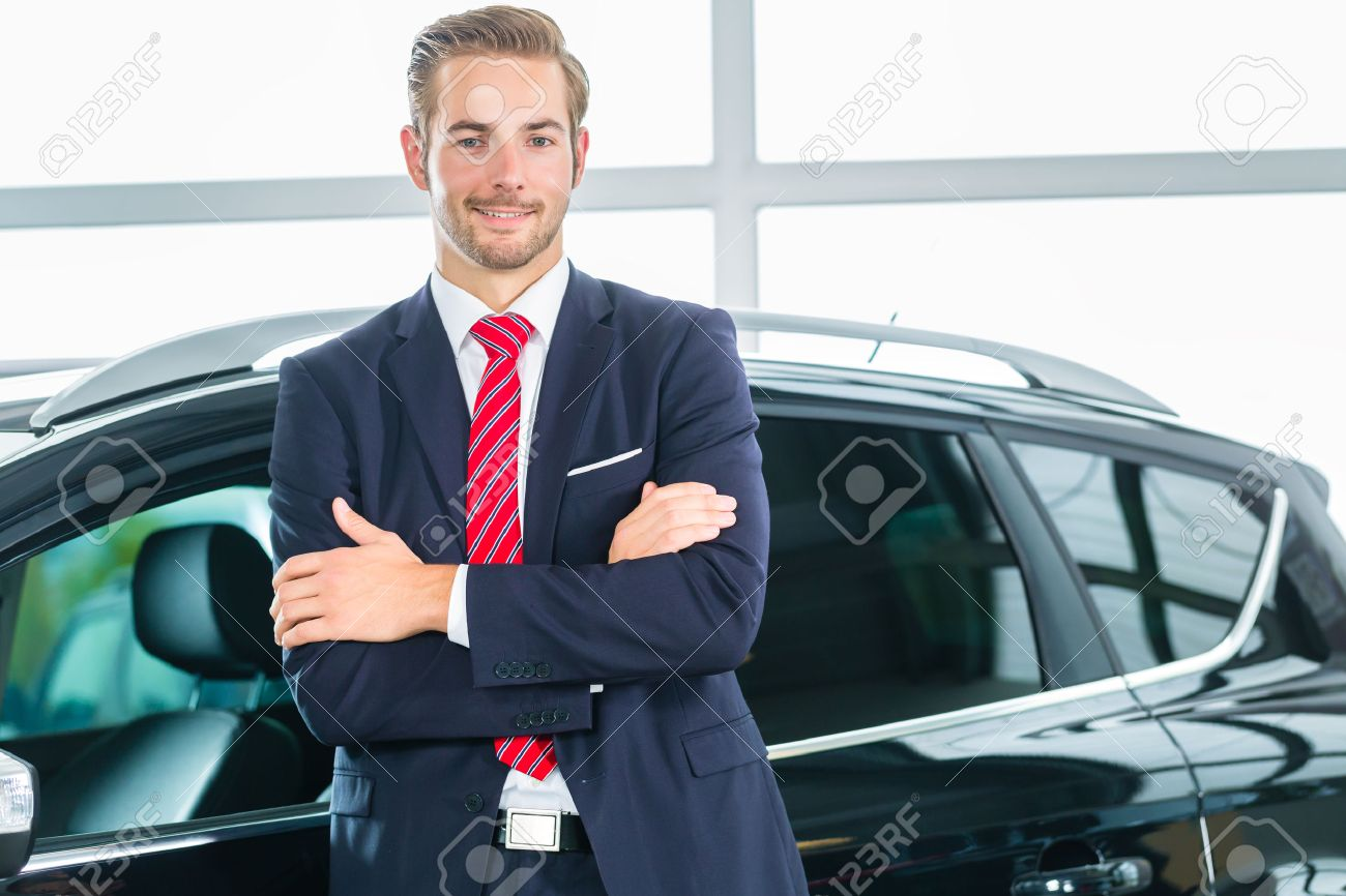 Seller Car >> Seller Or Car Salesman In Car Dealership Presenting His New And