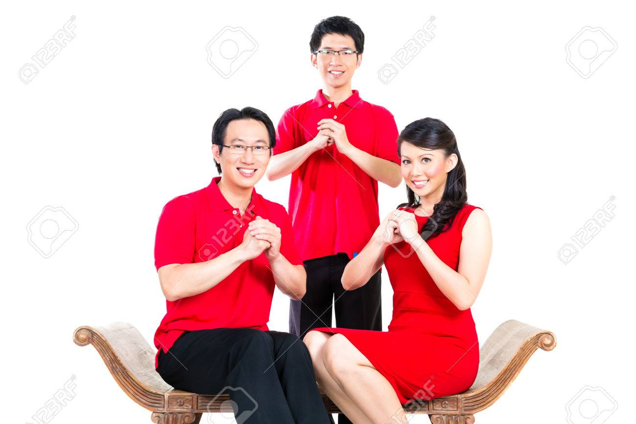 Family Celebrates Chinese New Year Traditional Greeting Wearing