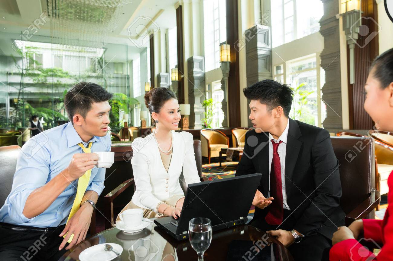 four asian chinese office people or businessmen and businesswomen