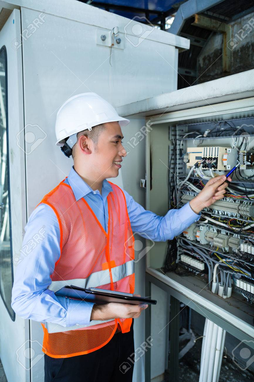Asian Indonesian Technician Or Electrician Making Function Test ...