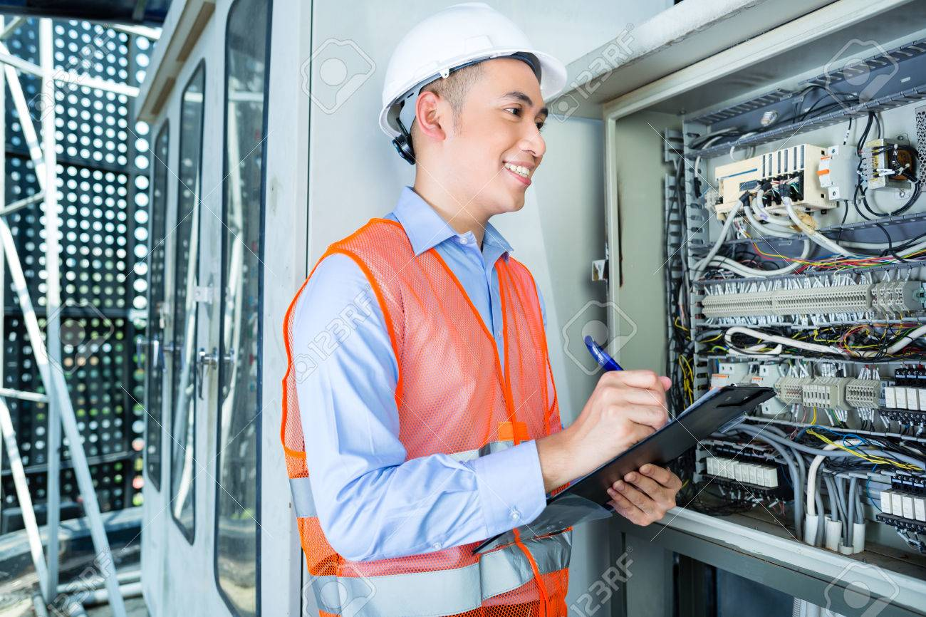 asian indonesian technician or electrician making function test rh 123rf com wiring technician for schneider electric wiring technician job description