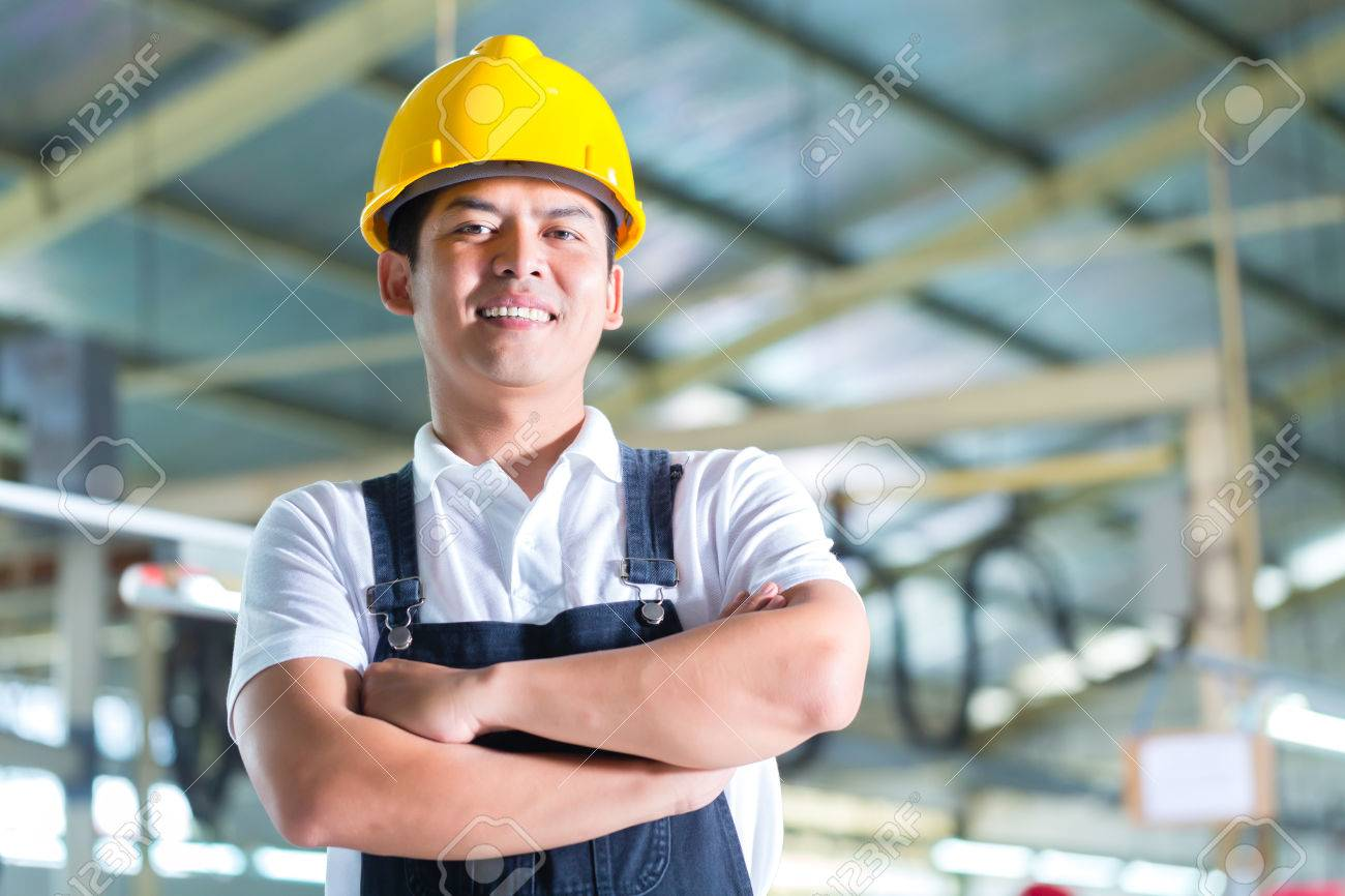 Indonesian Worker Or Production Manager Standing Proudly In A – Production Worker