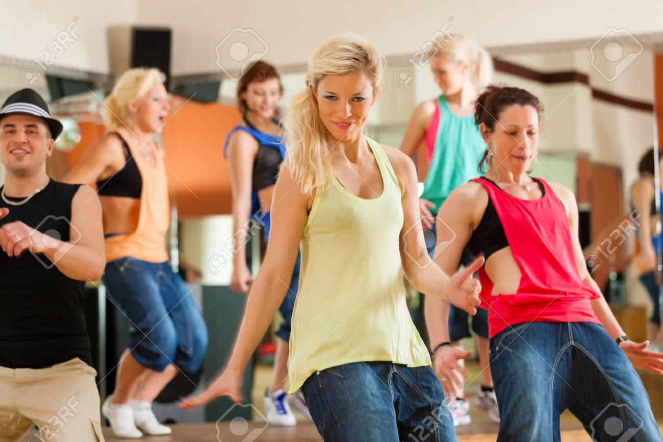Jazzdance - young people dancing in a studio or gym doing sports or practicing a dance number - 26361320