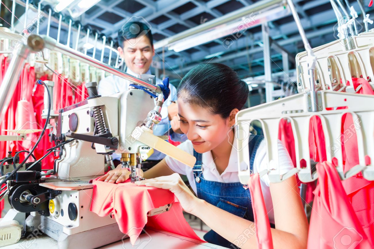 shift supervisor stock photos pictures royalty shift shift supervisor asian seamstress or worker in a textile factory sewing a industrial sewing