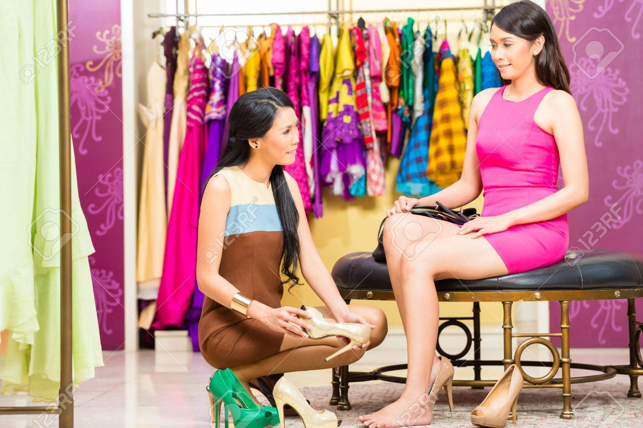 1c344be5d3 Asian young sales lady offering shoes to woman in fashion store Stock Photo  - 29284785