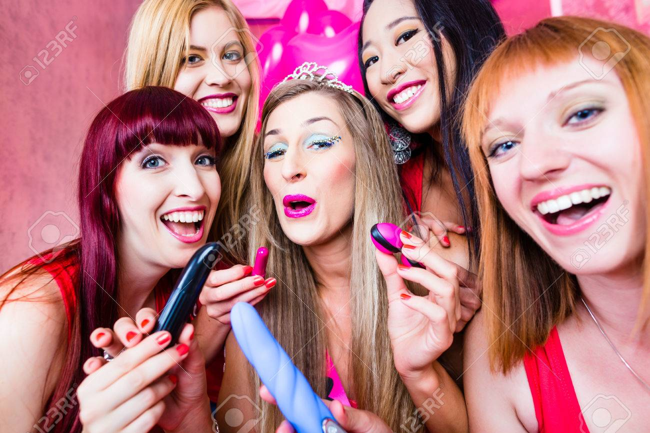 Bachelorette Sex Toys - Women having bachelorette party with sex toys in night club