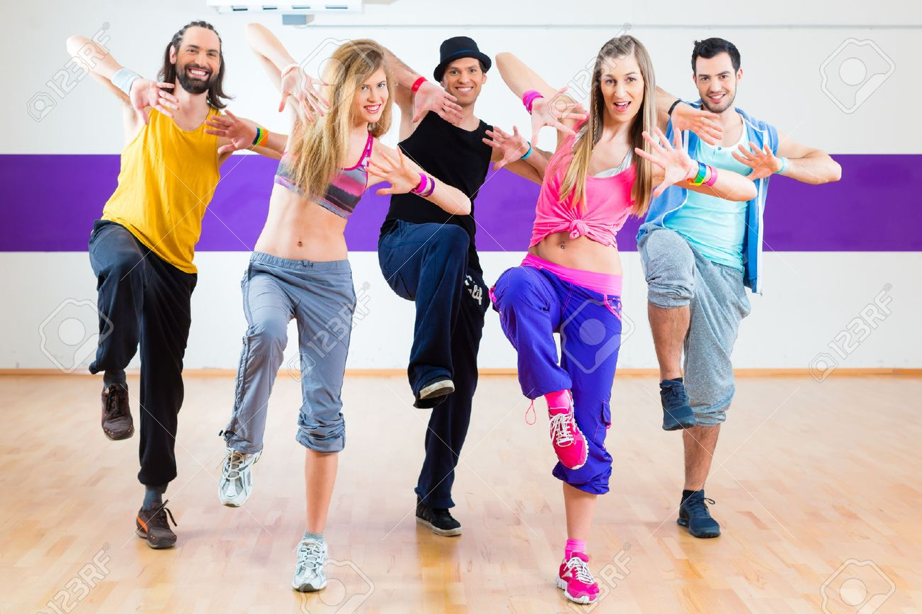 Group Of Men And Women Dancing Zumba Fitness Choreography In Dance School Stock Photo