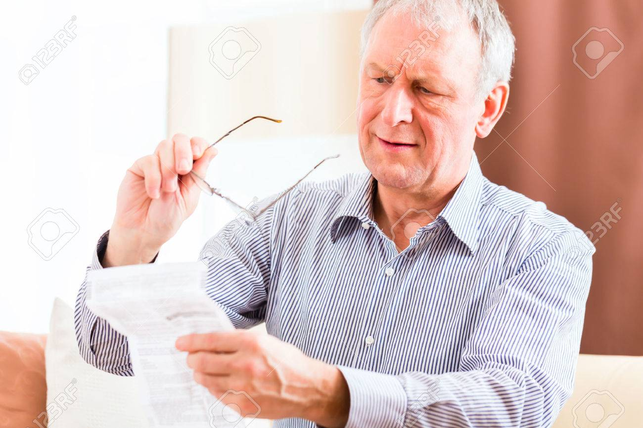 Old Man Reading Medicament Package Insert At Home With Glasses Stock Photo,  Picture And Royalty Free Image. Image 33413038.
