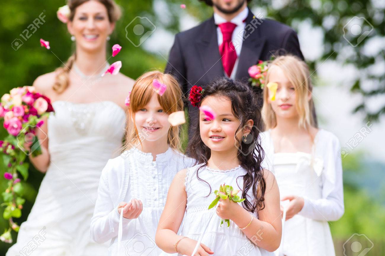 Wedding Couple Bride And Groom With Flower Children Or Bridesmaid ...