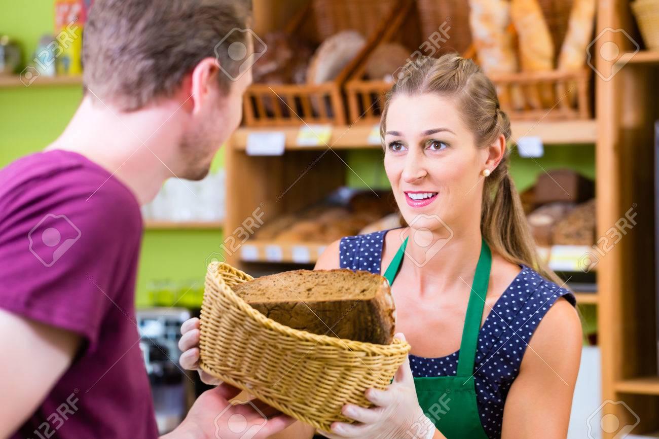 Female baker at organic supermarket bakery offering costumer bread Stock Photo - 33750012  sc 1 st  123RF.com & Female Baker At Organic Supermarket Bakery Offering Costumer.. Stock ...