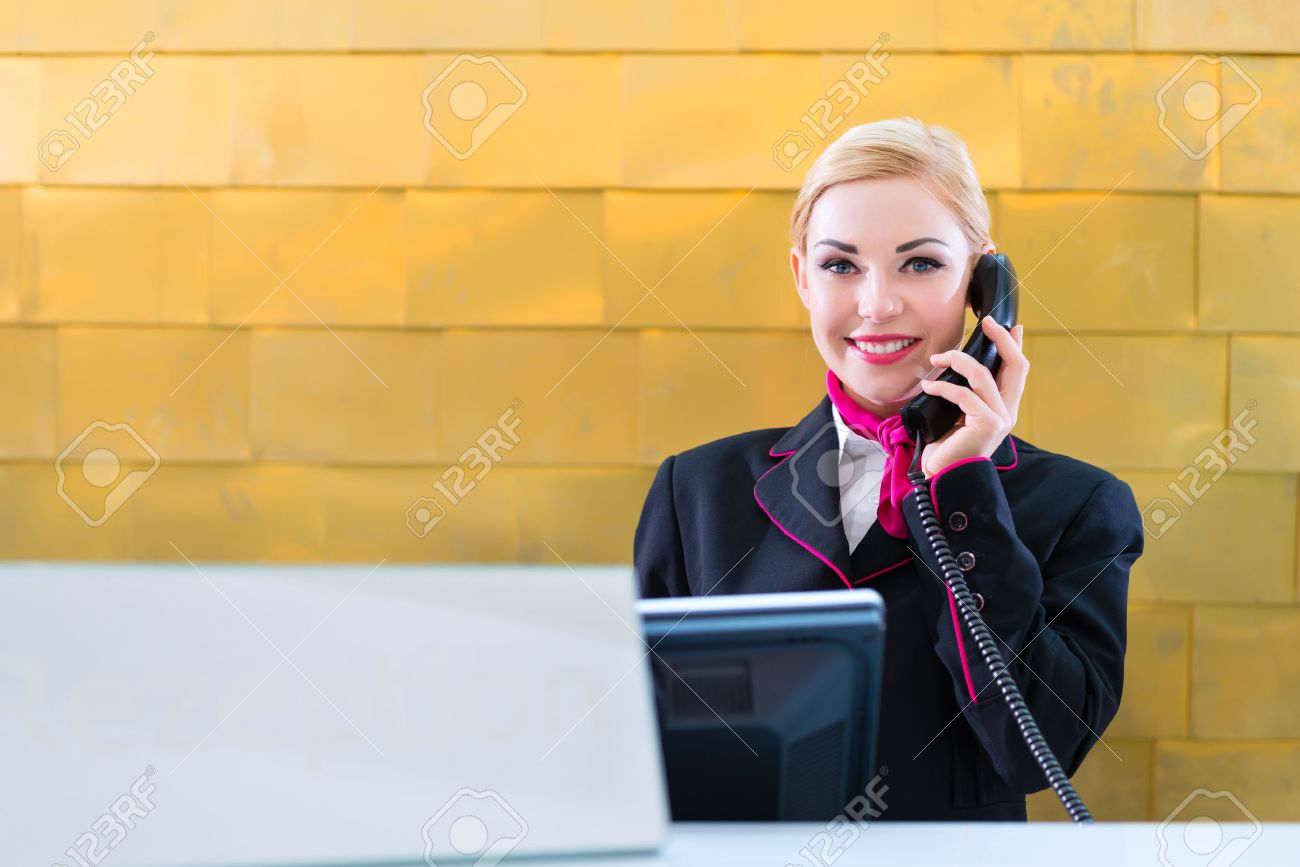 hotel receptionist phone on front desk stock photo picture hotel receptionist phone on front desk stock photo 33725030