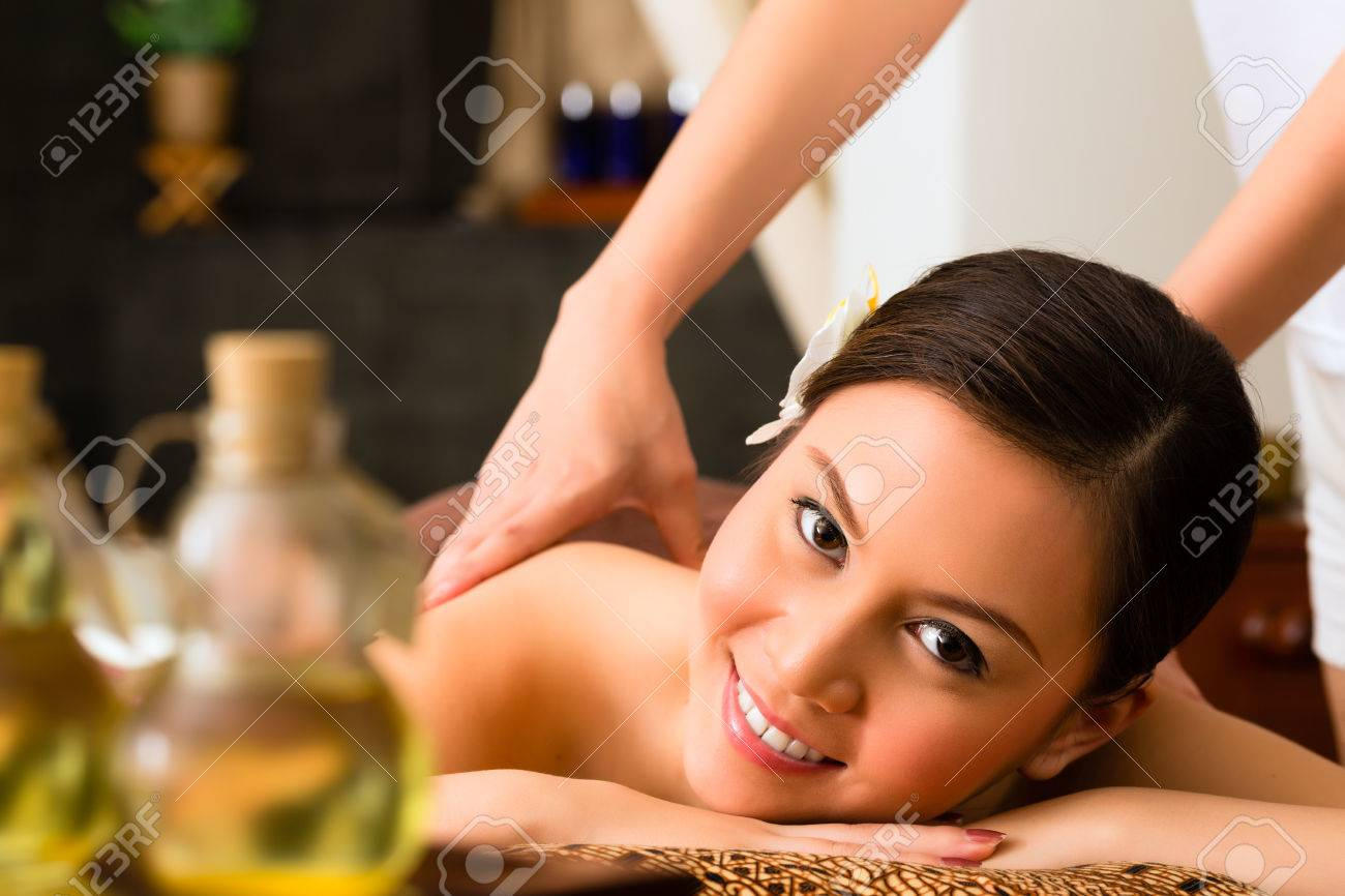 chinese asian woman in wellness beauty spa having aroma therapy