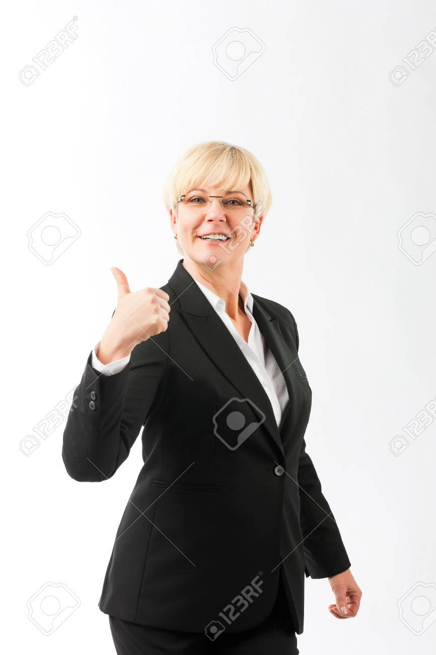 mature woman or lady with thumbs up, studio shoot stock photo