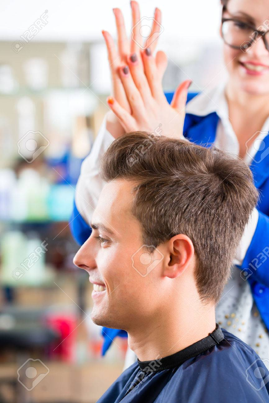 Female Coiffeur Cutting Men Hair In Hairdresser Shop Stock Photo ...