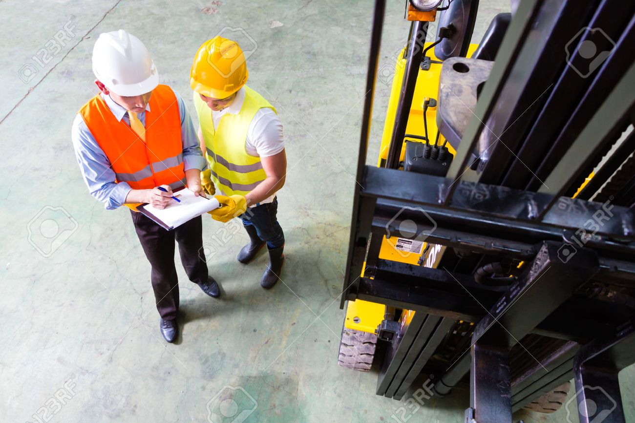 Asian fork lift truck driver discussing checklist with foreman asian fork lift truck driver discussing checklist with foreman in warehouse stock photo 33784456 publicscrutiny Image collections