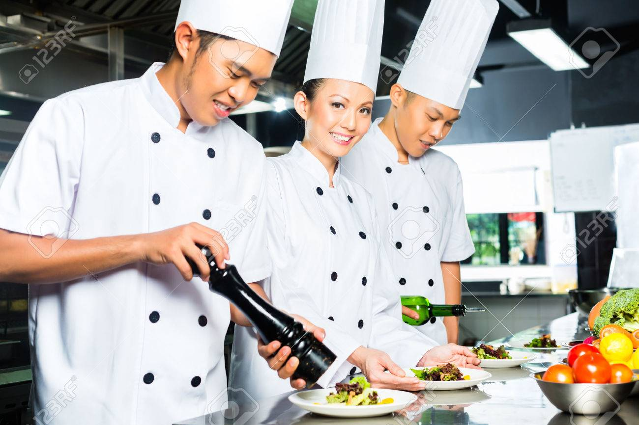 Asian Indonesian Chef Along With Other Cooks In Restaurant Or ...