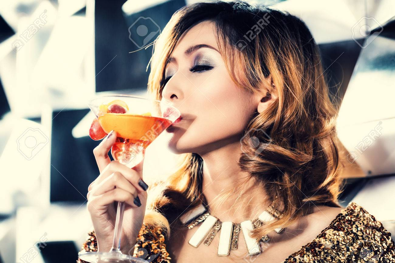 33785045-asian-girl-drinking-cocktail-in