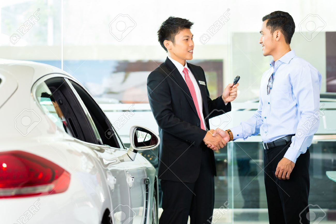 Asian Car Salesman Selling Auto To Customer Stock Photo, Picture ...