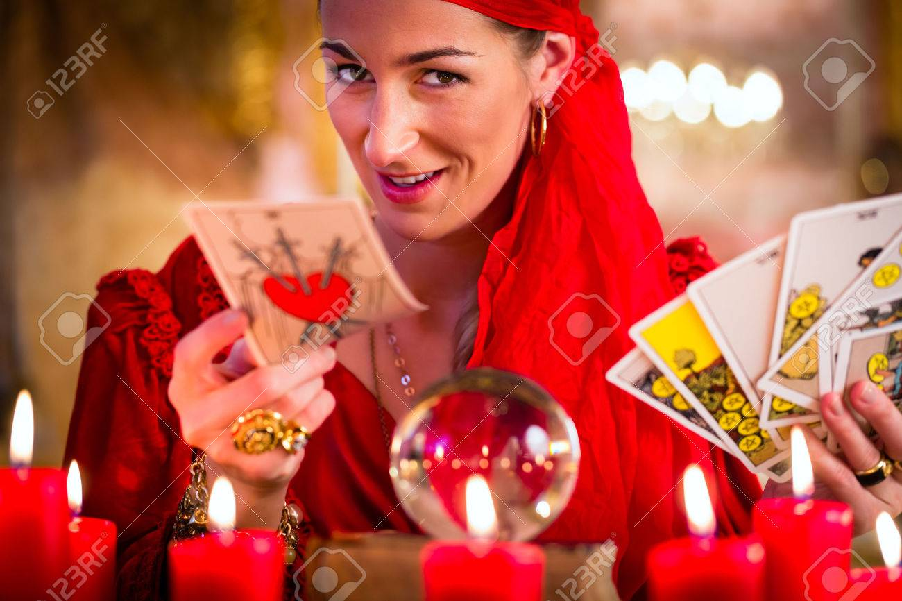 Fortuneteller with Tarot cards or esoteric Oracle, sees in the