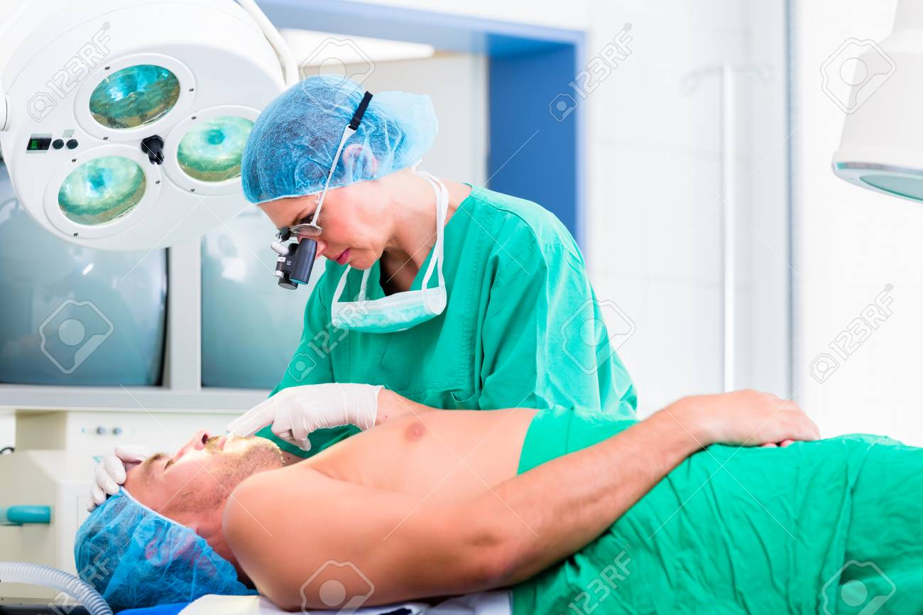 orthopedic surgeon doctor operating patient in surgery or hospital