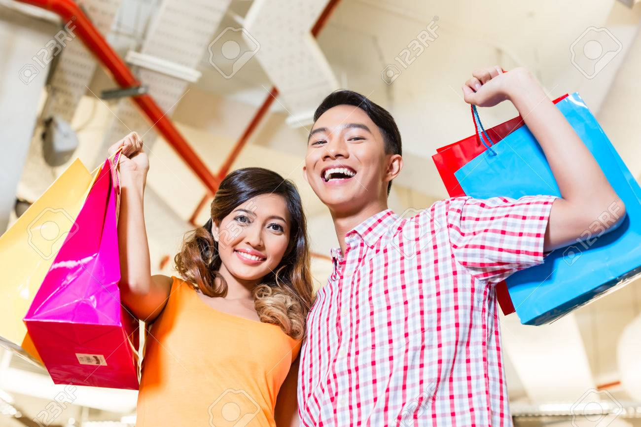f5d64f04f0 Asian couple shopping in fashion store or shop with lots of bags Stock  Photo - 37893707