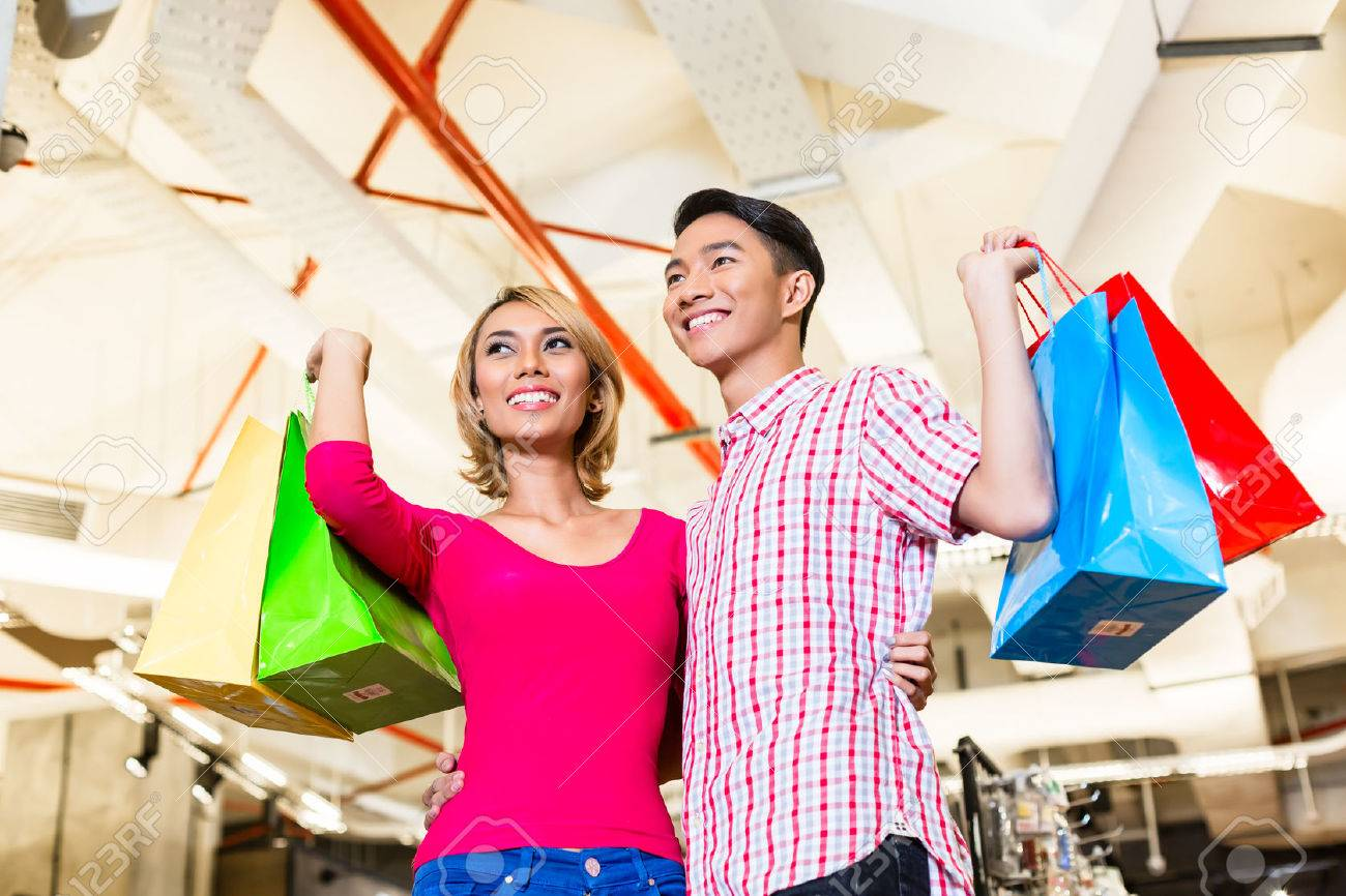 7769a88b26 Asian couple shopping in fashion store or shop with lots of bags Stock  Photo - 37893709