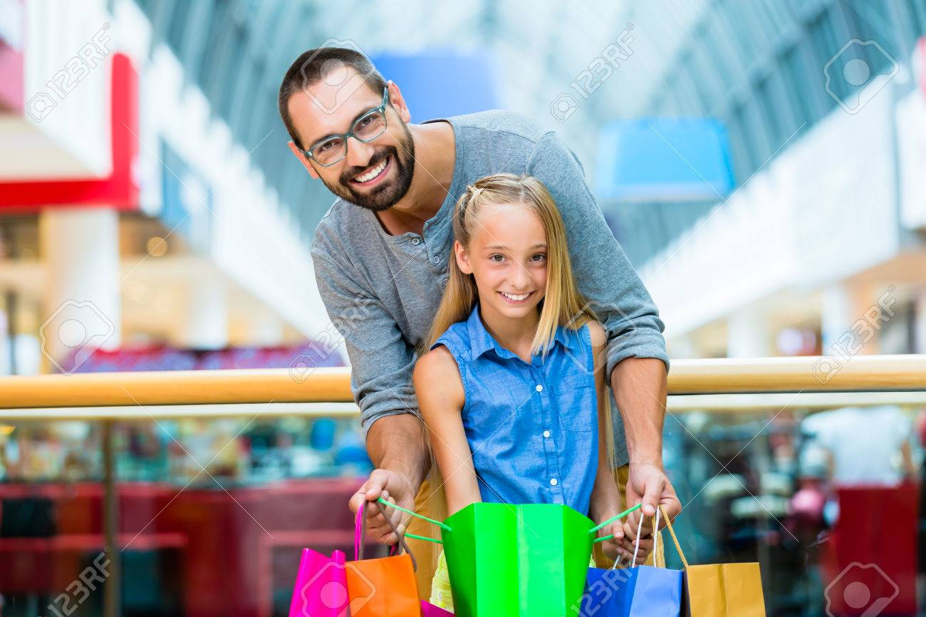 Dad With Daughter Shopping In Mall Stock Photo, Picture And ...
