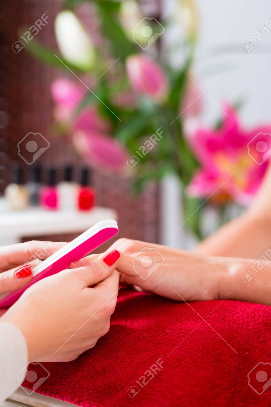 Woman Getting Manicure In Nail Parlor With File Stock Photo, Picture ...