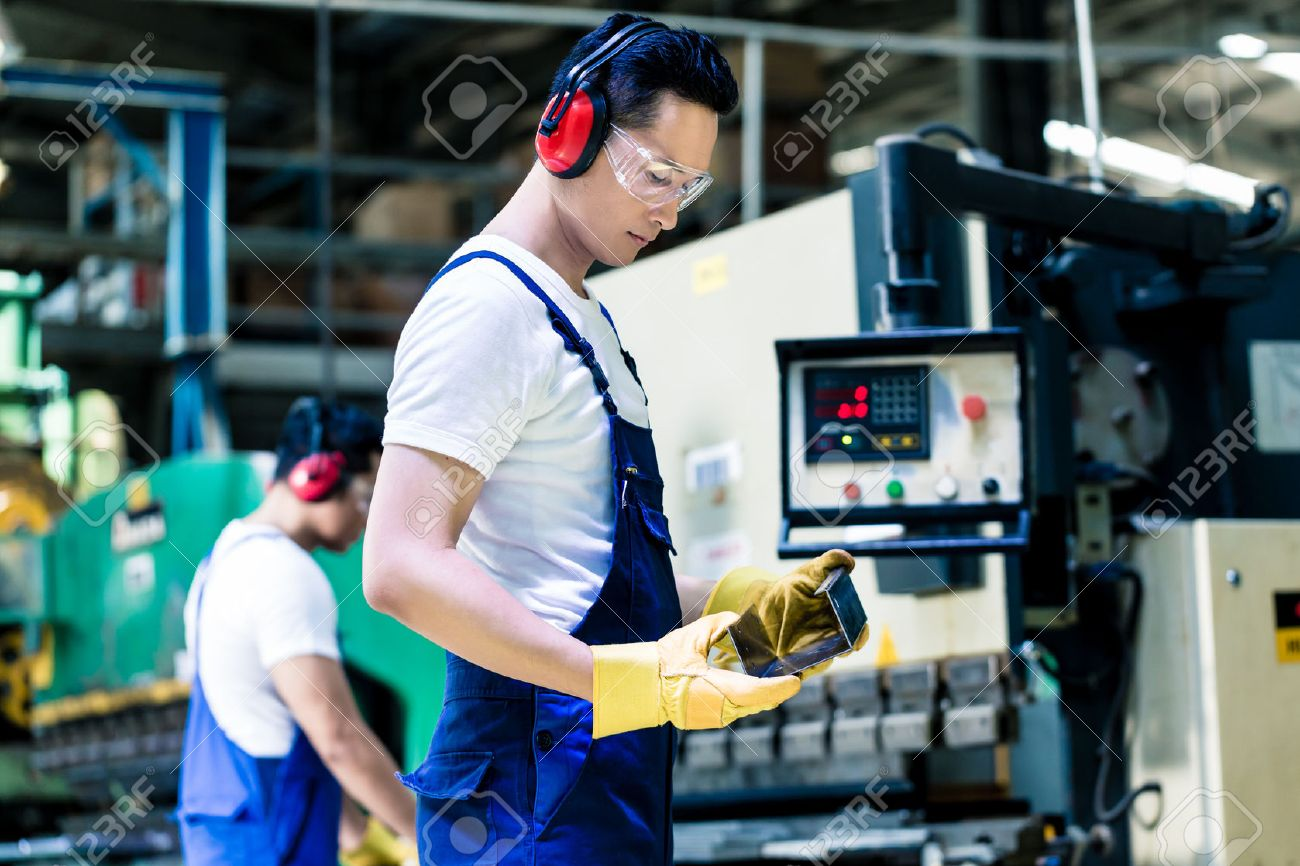 asian machine operator in production plant checking data stock photo 43779260 - Production Operator