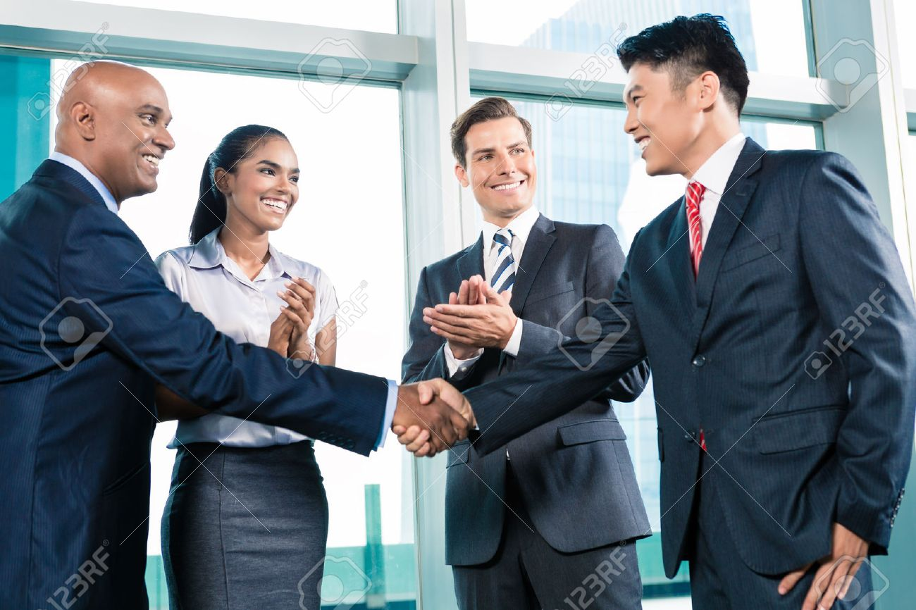 Business people handshake greeting deal at work photo free download - Business Handshake In Lofty Office With City View A Deal Is Struck Stock Photo