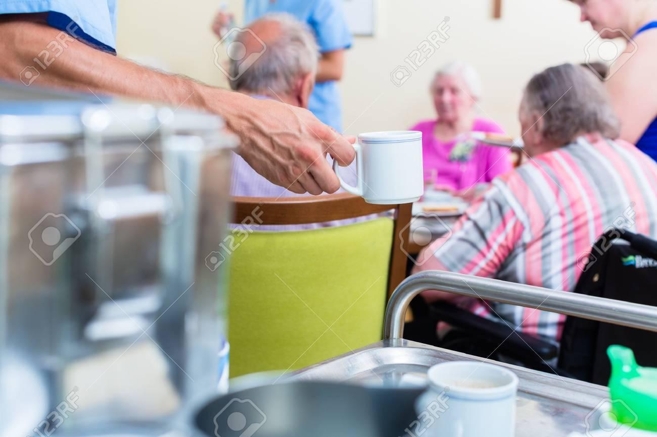 Nurse serving food in nursing home Standard-Bild - 51585614