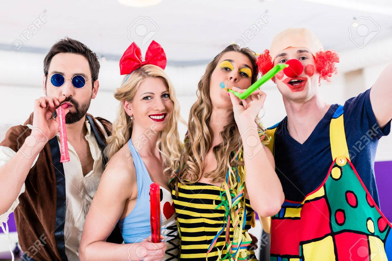 Party people celebrating carnival or new years eve Standard-Bild - 51585751