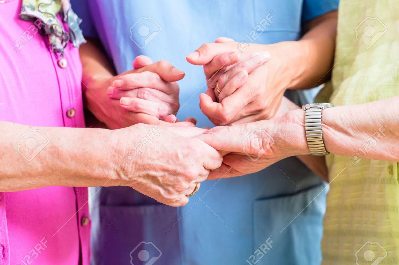 Elderly care nurse with two senior women Standard-Bild - 51585945