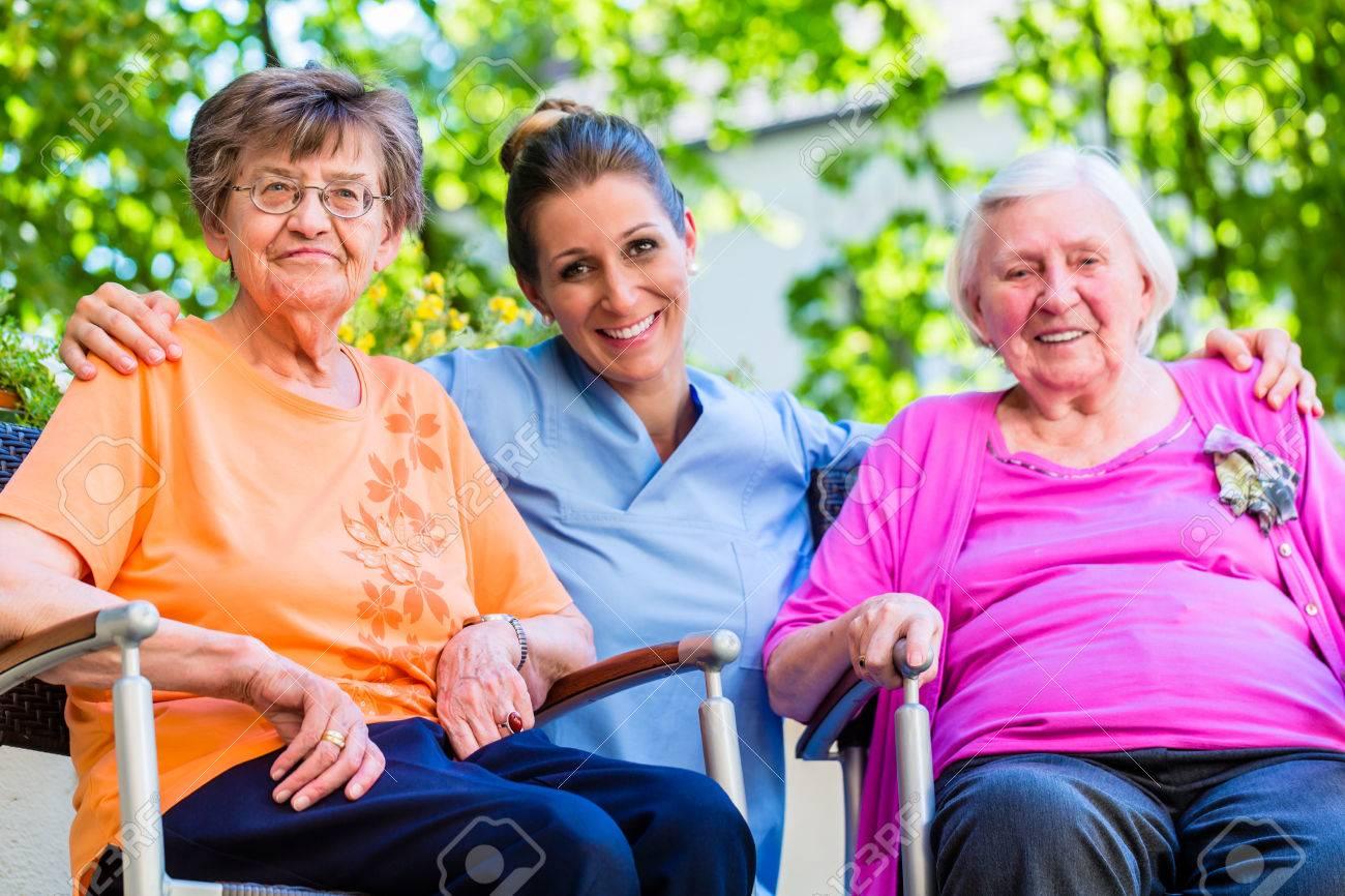 Geriatric nurse having chat with senior women Standard-Bild - 51756086
