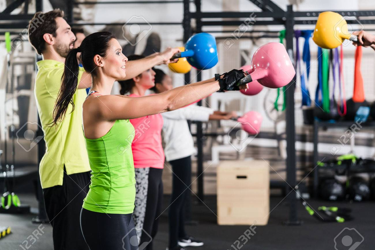 Functional fitness workout in sport gym with kettlebell Standard-Bild - 64981799