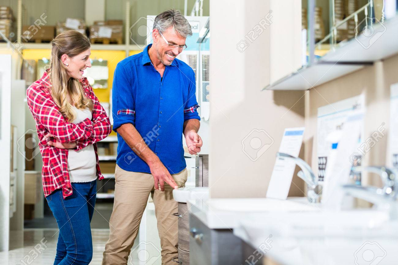 shop assistant in hardware store counseling customer about shop assistant in hardware store counseling customer about lavatories for do it yourself project