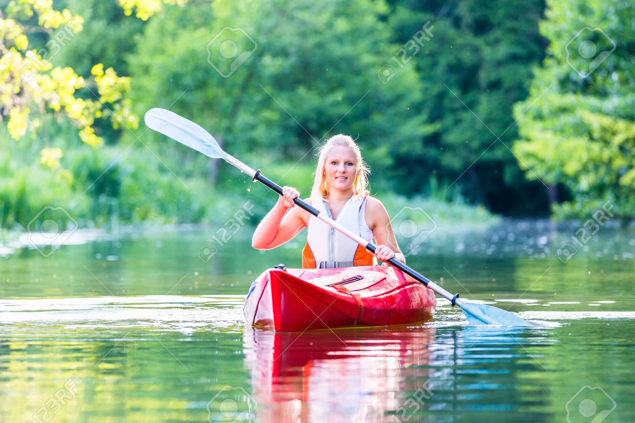 woman driving with kayak on forest river stock photo picture and