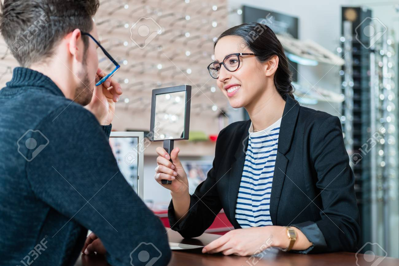 4b36eb51d7 Man in optician shop getting advice from saleswoman buying new glasses Stock  Photo - 88609806
