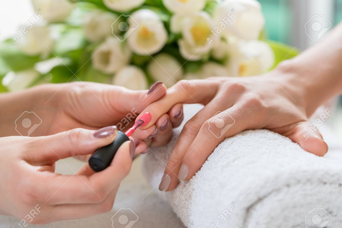 Close-up Of The Hands Of A Skilled Manicurist, Applying Elegant ...
